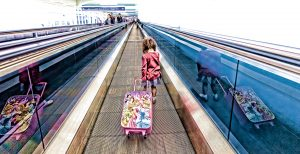 Kid Traveler in Airport by Mark Nicholas